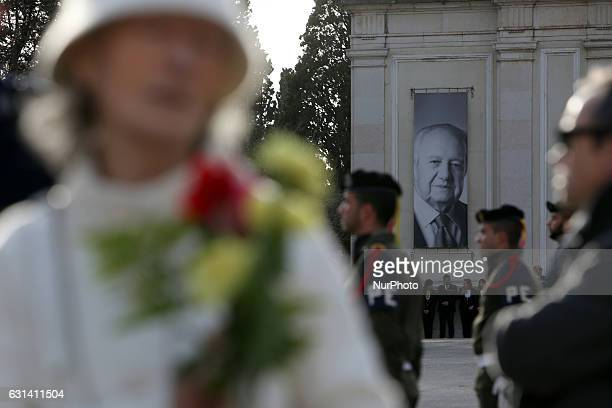 Portuguese military guards and guests pay tribute during the funeral of the late former Portuguese President Mario Soares at the Prazeres cemetery in...