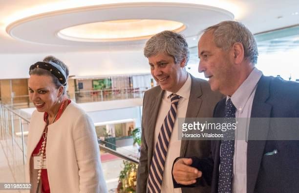 Portuguese Minister of Finance Mario Centeno is accompanied by Daniel Franklin Executive Editor of The Economist and the Managing Director of The...