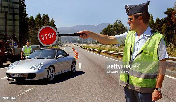 Portuguese national police stops a car at the frontier between Portugal and Spain in Valenca do Minho northern Portugal 11 June 2004 Portuguese...
