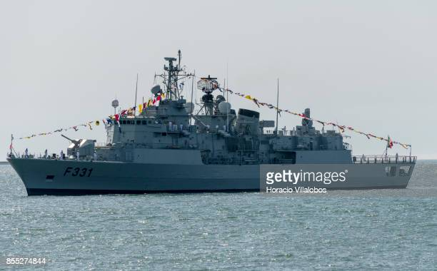 Portuguese Navy frigate NRP frigate Alvares Cabral hoists flags and banners while laying at anchor in Tagus River during the commemoration of the...