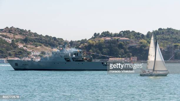 Portuguese Navy offshore patrol vessel NRP Viana do Castelo hoists flags and banners while laying at anchor in Tagus River during the commemoration...