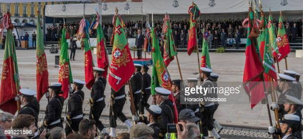 Portuguese Navy personnel parade with national flags before President Marcelo Rebelo de Sousa during the ceremony in Praca do Comercio to commemorate...