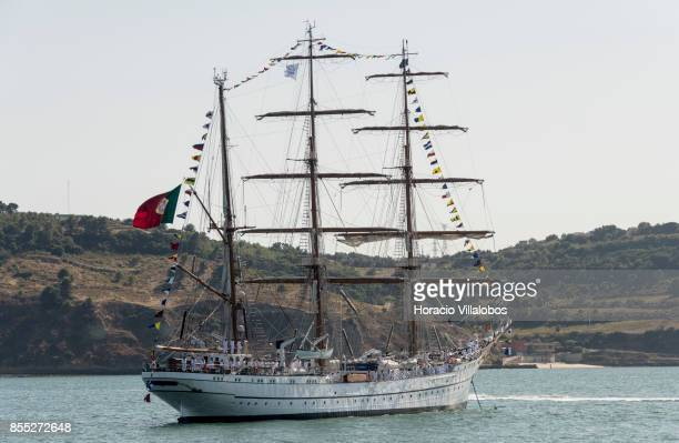 Portuguese Navy tall ship and school ship NRP Sagres hoists flags and banners while laying at anchor in Tagus River during the commemoration of the...