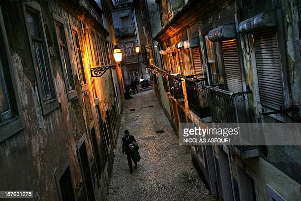 A Portuguese office worker walks trough a street as he makes his way back home in central Lisbon 07 March 2006