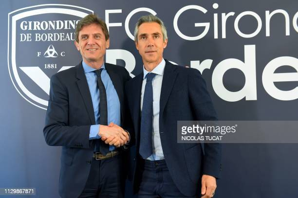Portuguese Paulo Sousa, Bordeaux's new head coach, poses for a photograph with Bordeaux's French president Frederic Longuepee during a press...