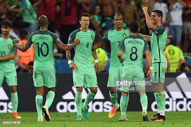 Portuguese players celebrate at the end of the Euro 2016 semifinal football match between Portugal and Wales at the Parc Olympique Lyonnais stadium...