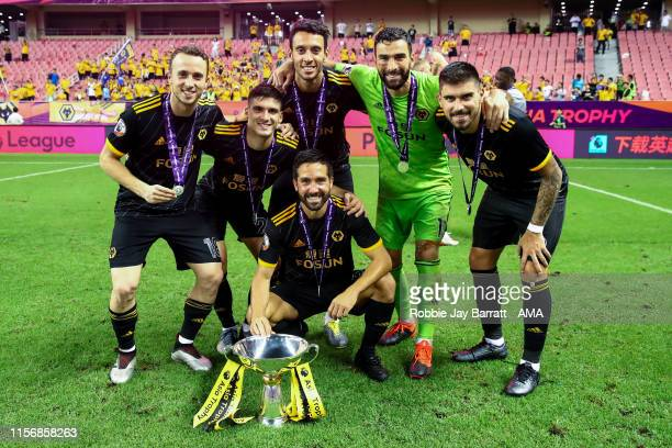 Portuguese players pose for a team photo during the Premier League Asia Trophy 2019 final fixture between Manchester City v Wolverhampton Wanderers...