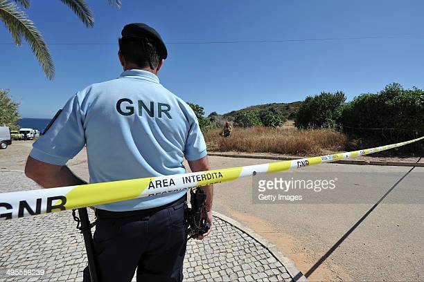 Portuguese police guarding the surrounding area of land as part of a new investigation into the disappearance Madeleine McCann on June 4, 2014 in...