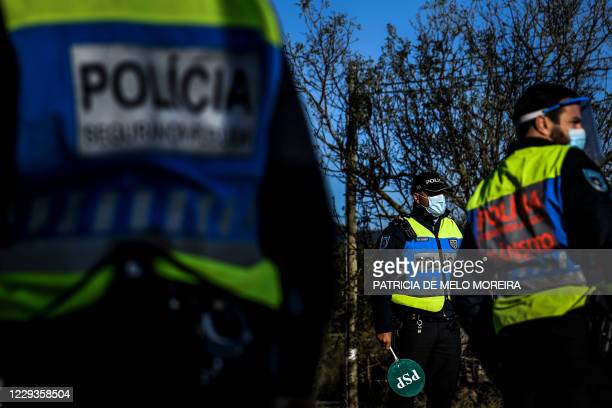 Portuguese police officers man a checkpoint at Vila Franca de Xira in Lisbon on October 30, 2020 as circulation between municipalities became...