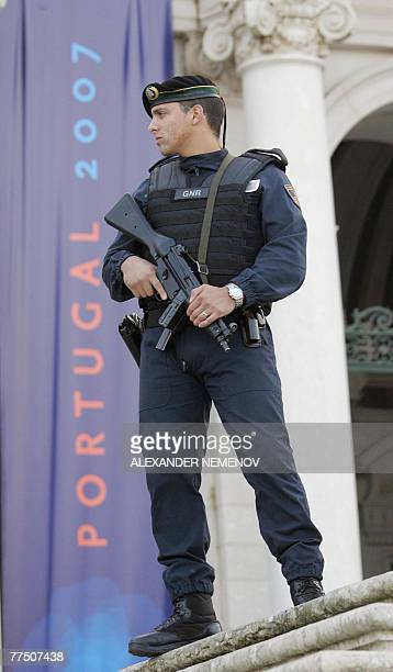 A Portuguese policeman guards the entrance to the EURussia summit in Mafra 26 October 2007 The EURussia summit which marks 10 years since Brussels...
