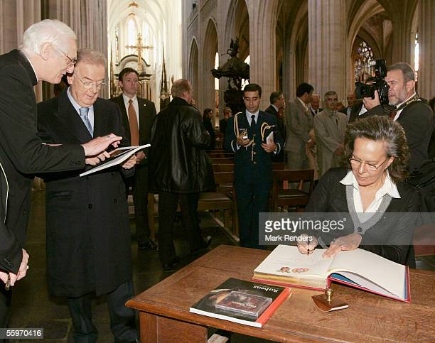 Portuguese President Jorge Sampaio and his wife Maria Jose Ritta sign the gilden book during their vist to the Cathedral on October 20 2005 in...