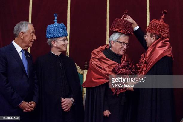 Portuguese President Marcelo Rebelo de Sousa and Coimbra University dean Joao Gabriel Silva smile as European Commission president Jean Claude...