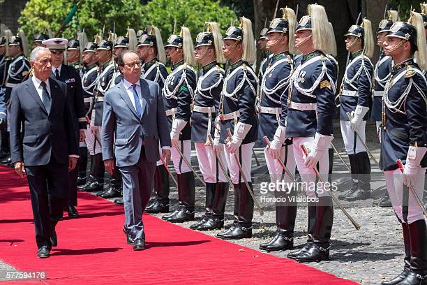 Portuguese President Marcelo Rebelo de Sousa and French President Francois Hollande review the guard of honor at Belem Palace on July 19, 2016 in...