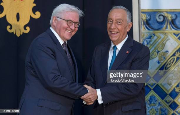 Portuguese President Marcelo Rebelo de Sousa and German President Frank-Walter Steinmeier shake hands and share a laugh before their meeting in Belem...