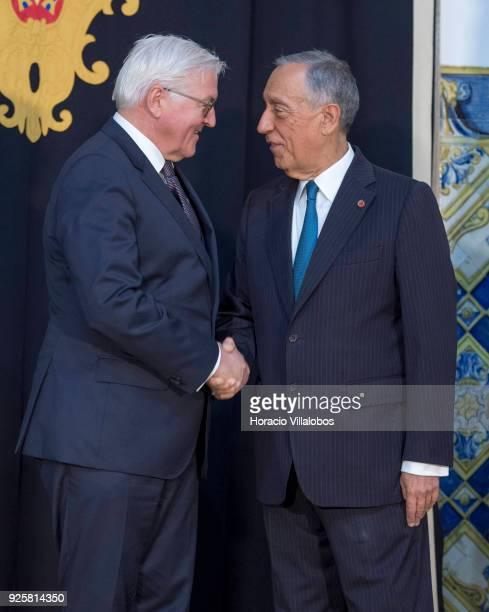 Portuguese President Marcelo Rebelo de Sousa and German President Frank-Walter Steinmeier shake hands before their meeting in Belem Presidential...