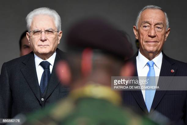 Portuguese President Marcelo Rebelo de Sousa and his Italian counterpart Sergio Mattarella stand watching a military parade at Jeronimos Monastery in...
