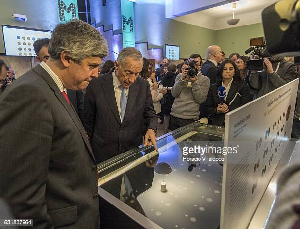 Portuguese President Marcelo Rebelo de Sousa and Minister of Finance Mario Centeno watch a temporary exhibit of ancient coins at the presentation of...