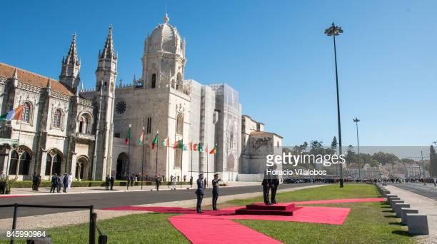 Portuguese President Marcelo Rebelo de Sousa and the President of Ivory Coast Alassane Dramane Ouattara listen to both countries national anthems...