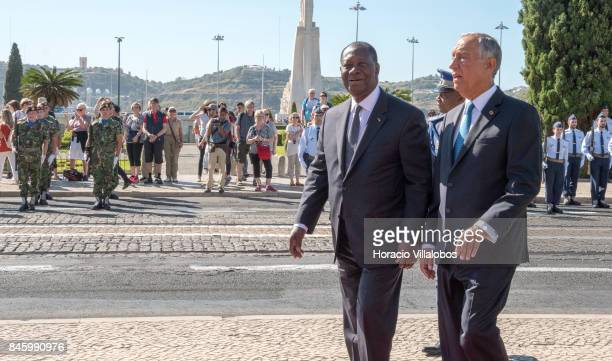 Portuguese President Marcelo Rebelo de Sousa and the President of Ivory Coast Alassane Dramane Ouattara walk away after reviewing the guard of honor...