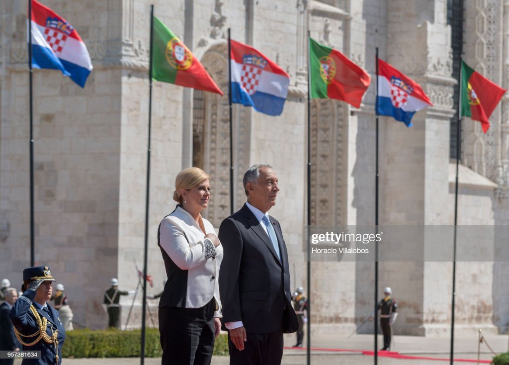 Portuguese President Marcelo Rebelo de Sousa (R) and the President of Croatia Kolinda Grabar-Kitarovic (L) listen to national anthems outside Jeronimos Monastery on May 11, 2018 in Lisbon, Portugal. President Kolinda Grabar-Kitarovic is on a two-days state visit to Portugal.