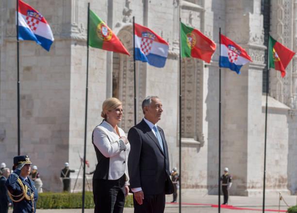 Portuguese President Marcelo Rebelo de Sousa and the President of Croatia Kolinda Grabar-Kitarovic listen to national anthems outside Jeronimos...