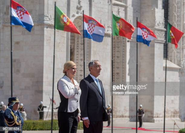 Portuguese President Marcelo Rebelo de Sousa and the President of Croatia Kolinda GrabarKitarovic listen to national anthems outside Jeronimos...