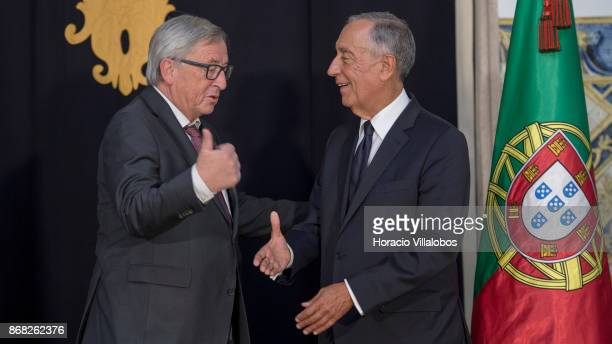 Portuguese President Marcelo Rebelo de Sousa and the President of the European Commission JeanClaude Juncker shake hands in Belem Palace on October...