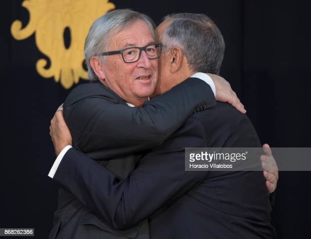 Portuguese President Marcelo Rebelo de Sousa and the President of the European Commission JeanClaude Juncker embrace in Belem Palace on October 30...