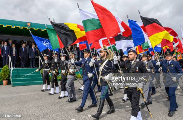 Portuguese President Marcelo Rebelo de Sousa bows as Portuguese Armed Forces personnel parade with NATO member flags during a ceremony staged by the...