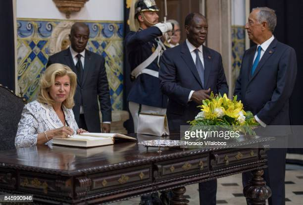 Portuguese President Marcelo Rebelo de Sousa chats with the President of Ivory Coast Alassane Dramane Ouattara while his wife Dominique Ouattara...