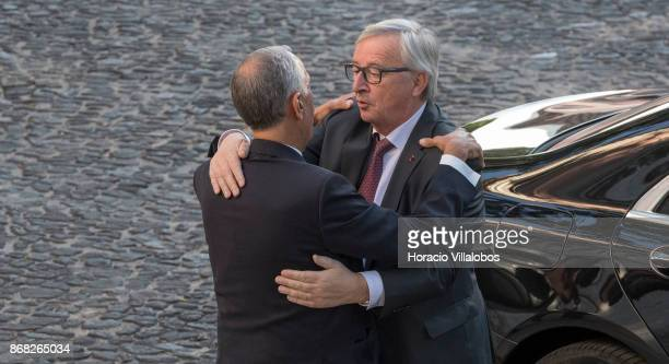 Portuguese President Marcelo Rebelo de Sousa embraces the President of the European Commission Jean-Claude Juncker at his arrival in Belem Palace on...