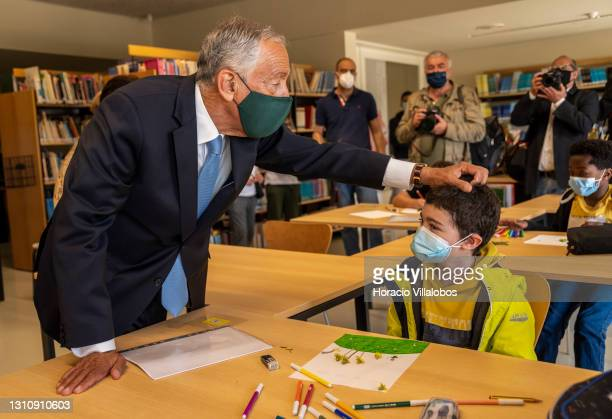 Portuguese President Marcelo Rebelo de Sousa is accompanied by the Minister of Education Tiago Brandão Rodrigues on a visit to Escola Básica...
