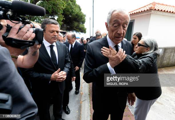 Portuguese President, Marcelo Rebelo de Sousa, is conforted by a woman in Canico, on April 19 close the place where a tourist bus crashed on April...