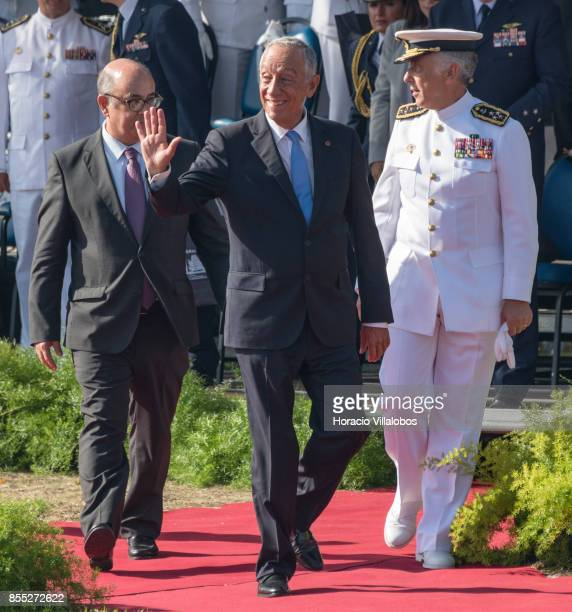 Portuguese President Marcelo Rebelo de Sousa is flanked by Portuguese Minister of National Defense Jose Alberto Azeredo Lopes and Navy Chief of Staff...
