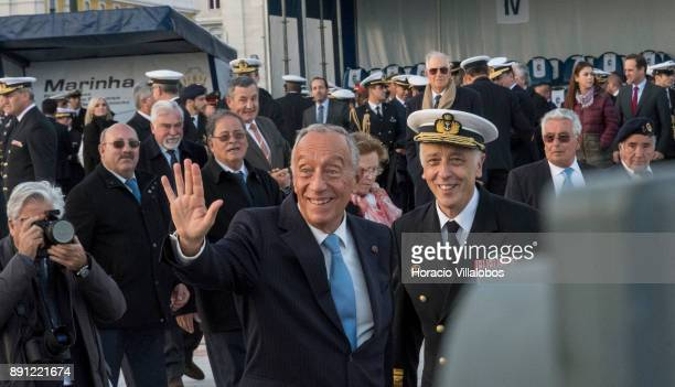Portuguese President Marcelo Rebelo de Sousa is flanked by Portuguese Navy Chief of General Staff Admiral Antonio Manuel Fernandes da Silva Ribeiro...