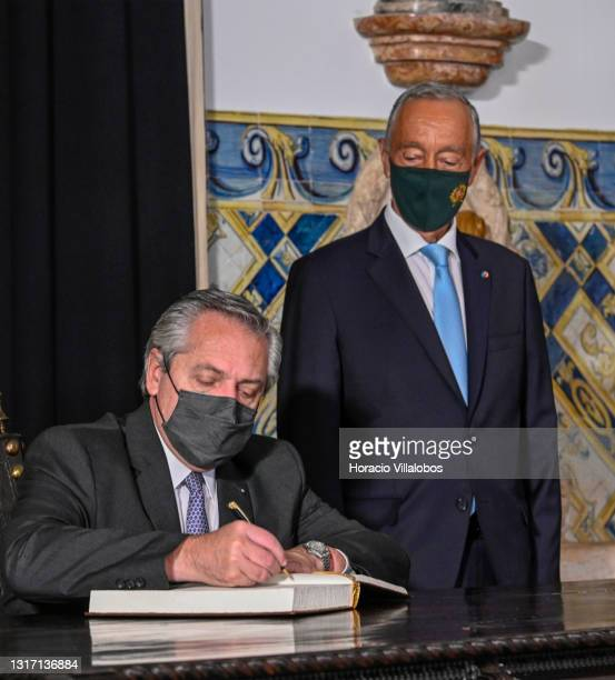 Portuguese President Marcelo Rebelo de Sousa looks on as Argentina's President Alberto Fernández signs the honors book in Belem Presidential Palace...