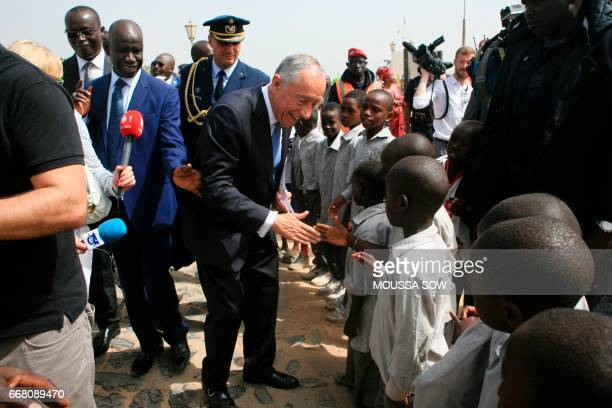 Portuguese President Marcelo Rebelo de Sousa meets children on April 13 prior to visiting the House of Slaves a museum and memorial to the Atlantic...