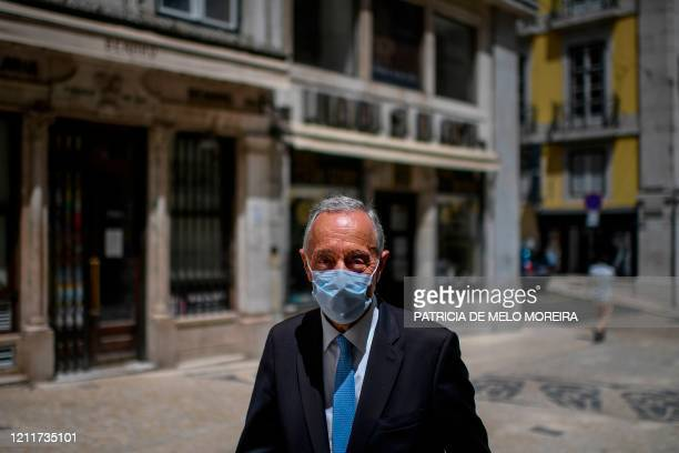 Portuguese President Marcelo Rebelo de Sousa poses with a face mask on his way to a bookshop to support local shops at Chiado in Lisbon on May 4,...