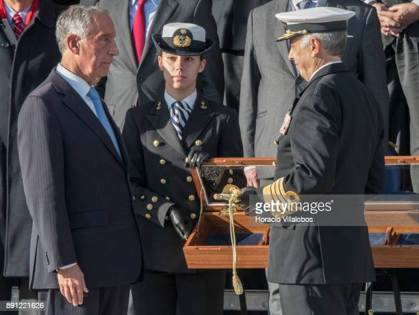 Portuguese President Marcelo Rebelo de Sousa receives a naval sword from Portuguese Navy Chief of General Staff Admiral Antonio Manuel Fernandes da...