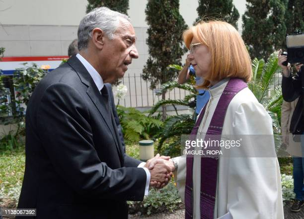 Portuguese President Marcelo Rebelo de Sousa shakes hands with German pastor Ilse Everlien Berardo prior to saying mass in Funchal, on April 19...