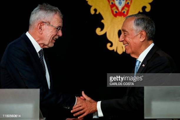 Portuguese President Marcelo Rebelo de Sousa shakes hands with his Austrian counterpart Alexander Van der Bellen after holding a joint press...