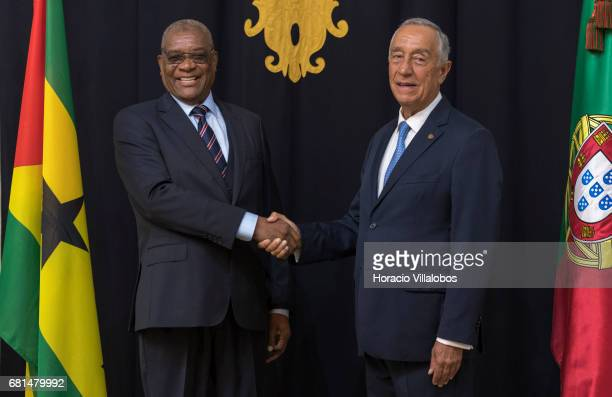 Portuguese President Marcelo Rebelo de Sousa shakes hands with President of Sao Tome and Prince Evaristo do Espirito Santo Carvalho at the...