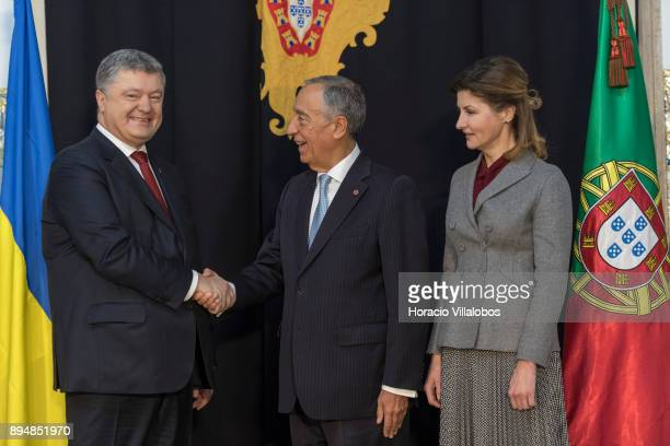 Portuguese President Marcelo Rebelo de Sousa shakes hands with the President of Ukraine Petro Poroshenko while First Lady Maryna Poroshenko looks at...