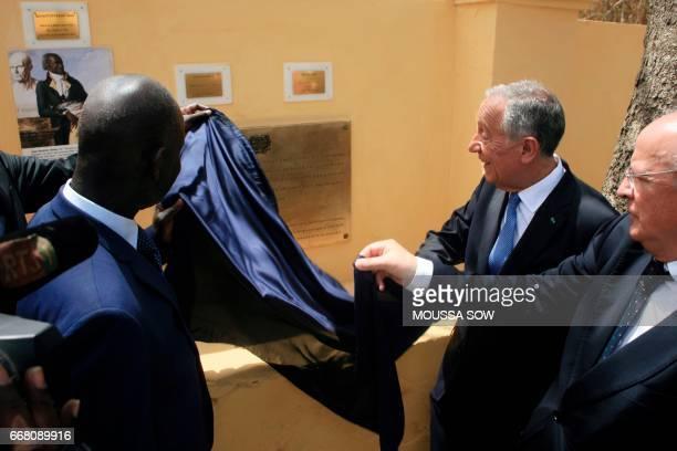Portuguese President Marcelo Rebelo de Sousa unveils a commemorative plaque as he visits the House of Slaves a museum and memorial to the Atlantic...