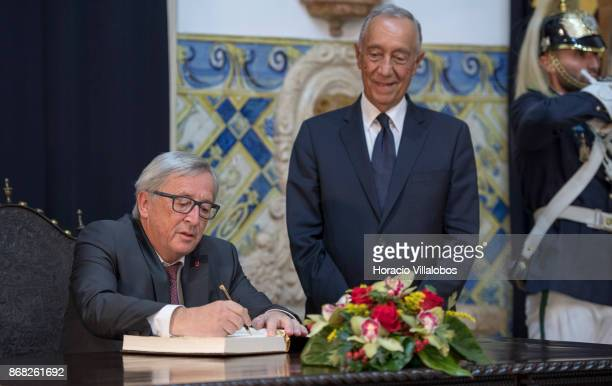 Portuguese President Marcelo Rebelo de Sousa watches the President of the European Commission JeanClaude Juncker signing the honor book in Belem...