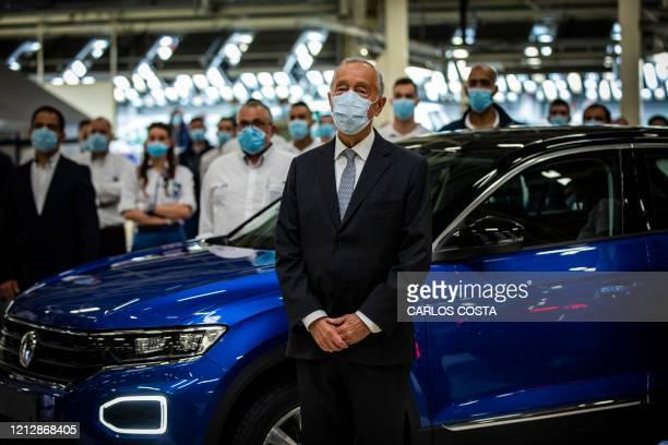 Portuguese President Marcelo Rebelo de Sousa wearing a face mask visits the Volkswagen Autoeuropa car factory in Palmela, 30 kms south of Lisbon, on...
