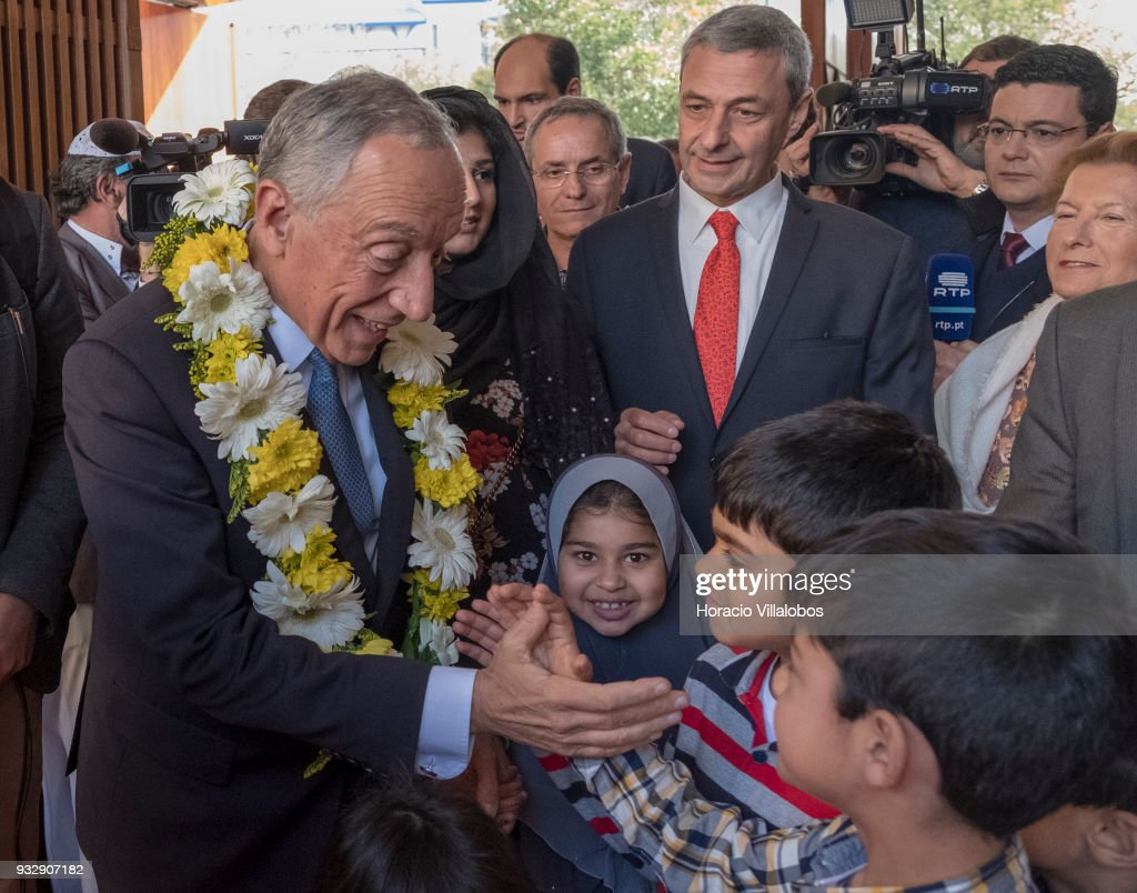 Portuguese President Marcelo Rebelo de Sousa wears a garland of flowers while being greeted by community children in the city's Central Mosque upon his arrival to attend the ceremony commemorating the 50th anniversary of the Islamic community of Lisbon on March 15, 2018 in Lisbon, Portugal. Nowadays Islamic population in Portugal, a territory once under Moors' rule, is being estimated as some 40.000.