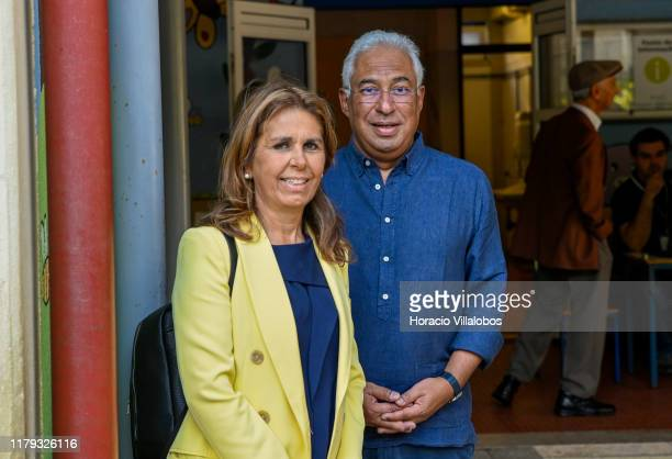 Portuguese Prime Minister and Secretary general of Socialist Party Antonio Costa stands with his wife Fernanda Maria Gonçalves Tadeu after casting...