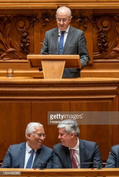 Portuguese Prime Minister Antonio Costa and Finance Minister Mario Centeno smile as the President of the Social Democratic Party Rui Rio takes the...