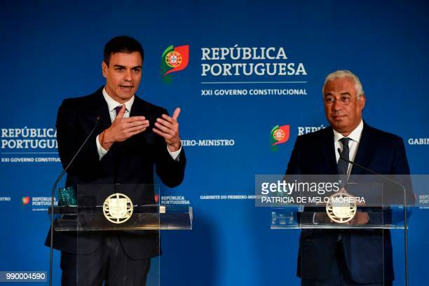 Portuguese Prime Minister Antonio Costa and his Spanish counterpart Pedro Sanchez give a joint press conference after their meeting at Comercio...